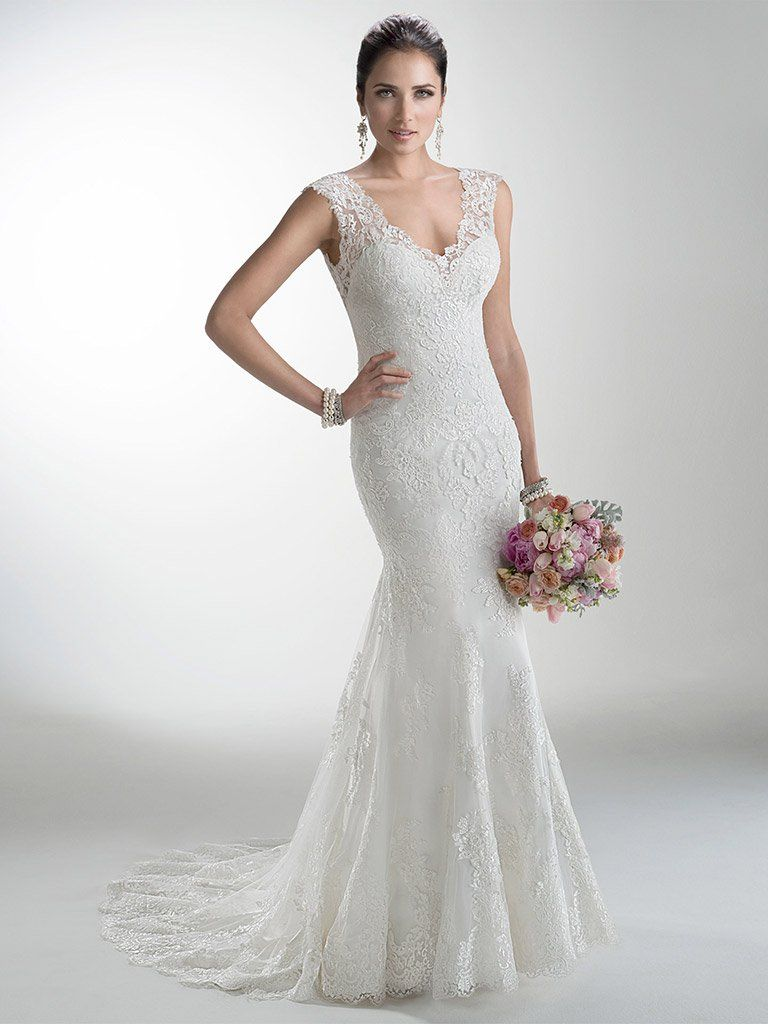 The Best Slip Dresses for the Chic and Relaxed Bride. Melanie by Maggie Sottero features delicate corded lace on tulle skims the shoulders and neckline of this lightweight wedding dress with attached Monroe slip dress while buttons trail a zipper closure accenting a deep, illusion back.