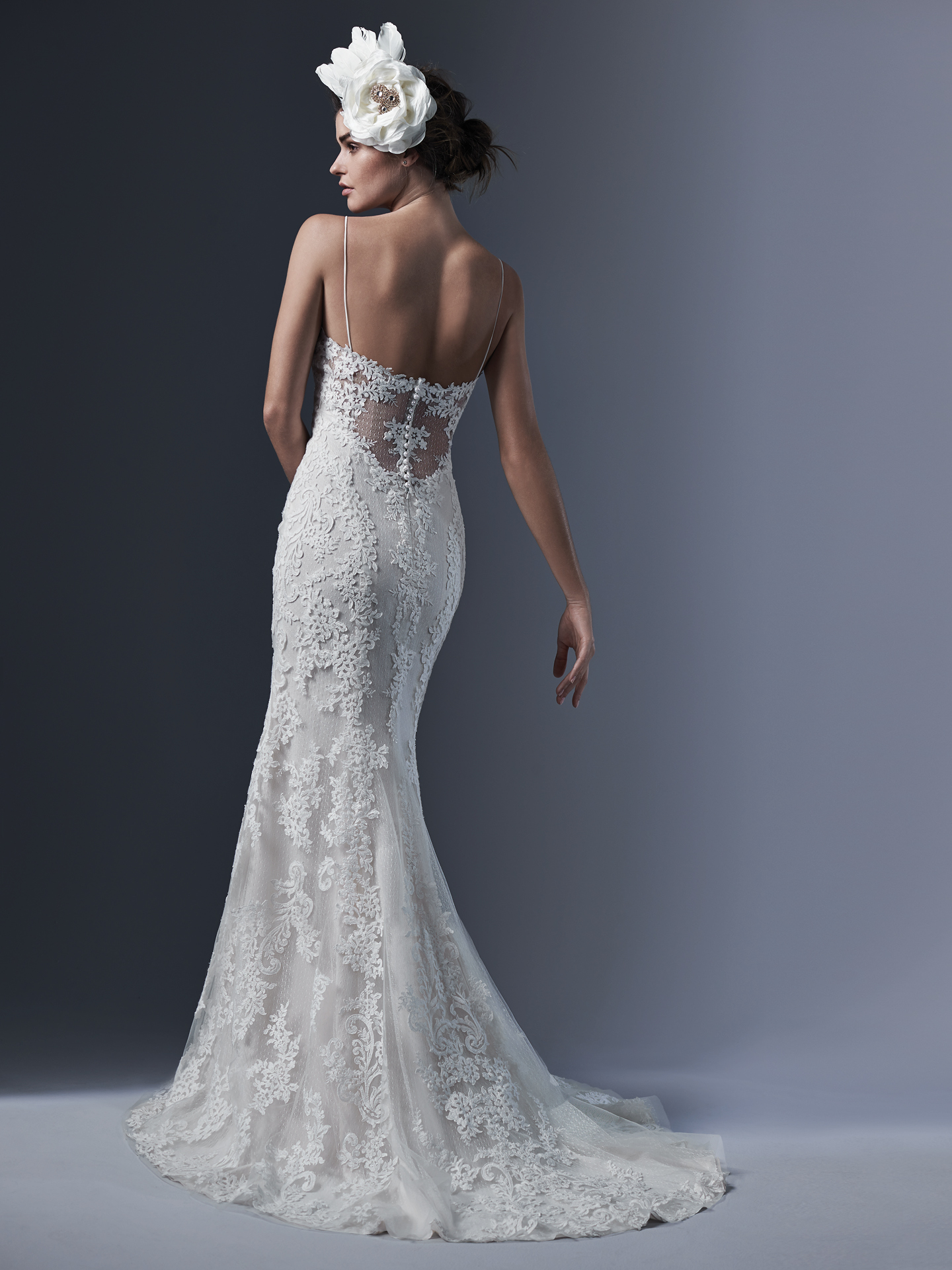 Mattea by Sottero and Midgley. Refined elegance is found in this chic lace sheath wedding dress; accented with sexy spaghetti straps; demure illusion back and V-neckline. Finished with pearl buttons and zipper closure.