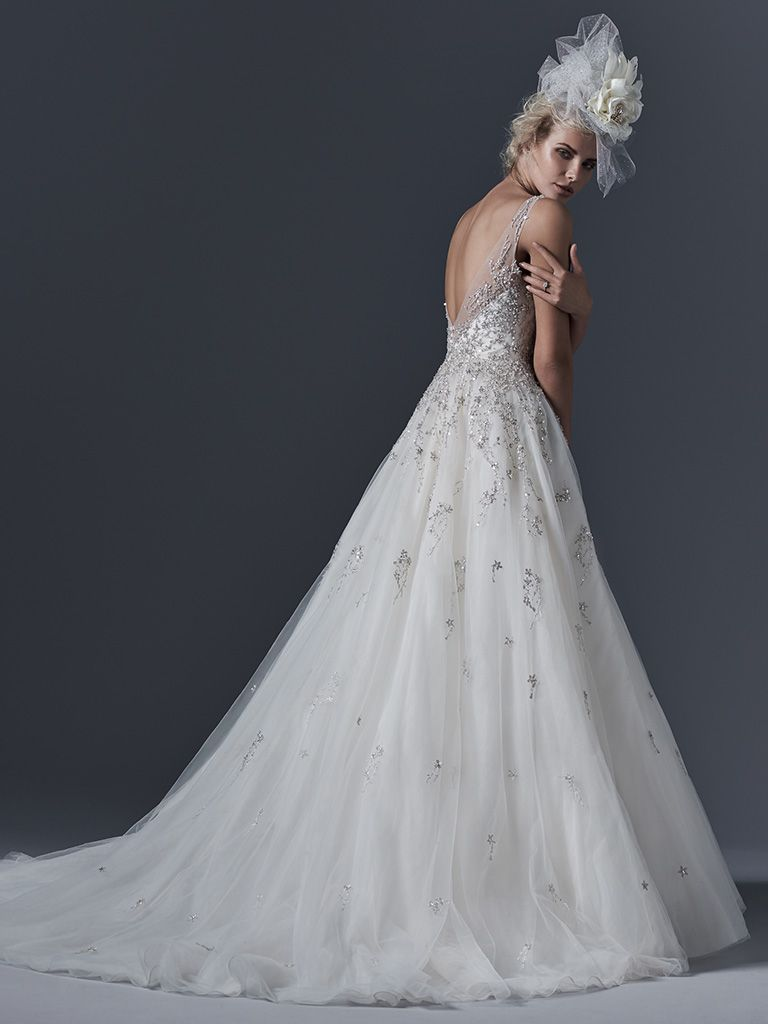 Beautiful ballgowns: Abrianna by Sottero and Midgley. Ethereal tulle creates this stunning modern ball gown; adorned with Swarovski crystals and sparkling beaded lace. A plunging neckline and backline complete the look. Finished with crystal button and zipper closure.