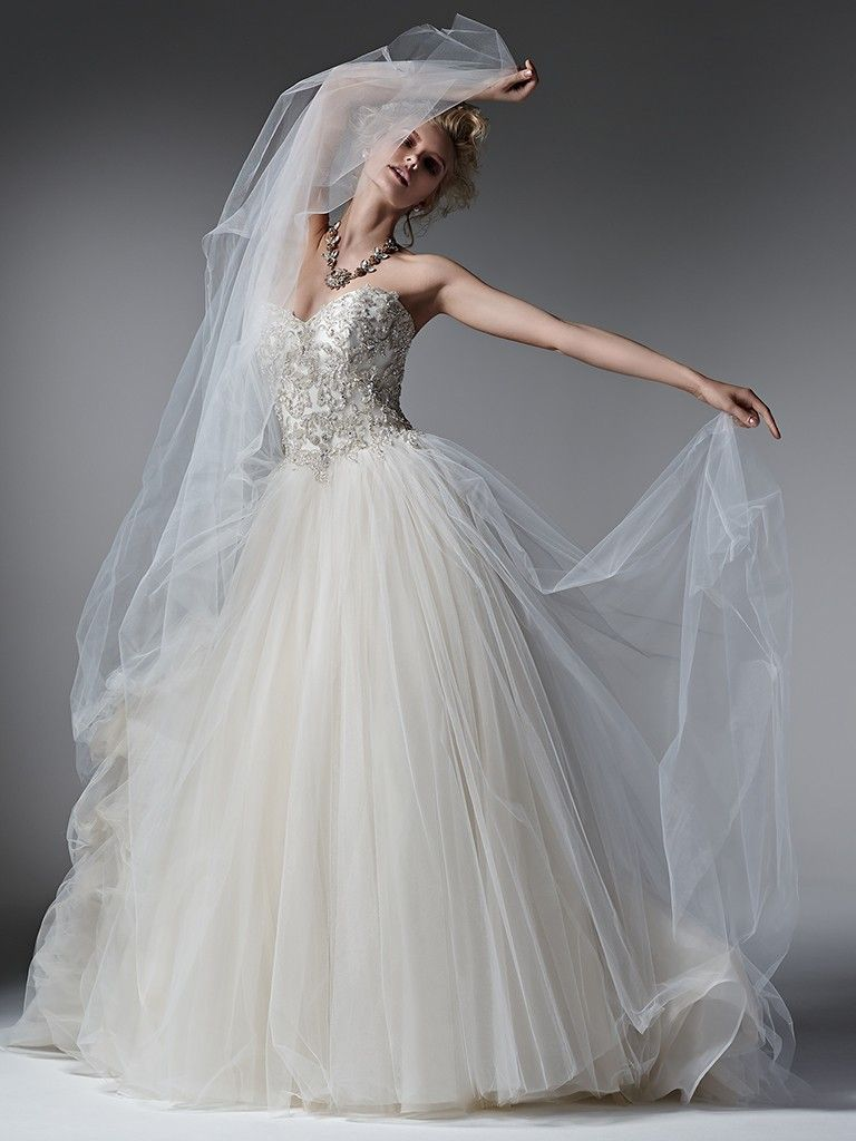 Beautiful ballgowns: Layla by Sottero and Midgley. Whimsical layers of tulle create the skirt of this romantic ball gown wedding dress, while sparkling Swarovski crystals, pearls and beads adorn the bodice. Finished with sweetheart neckline and corset closure.