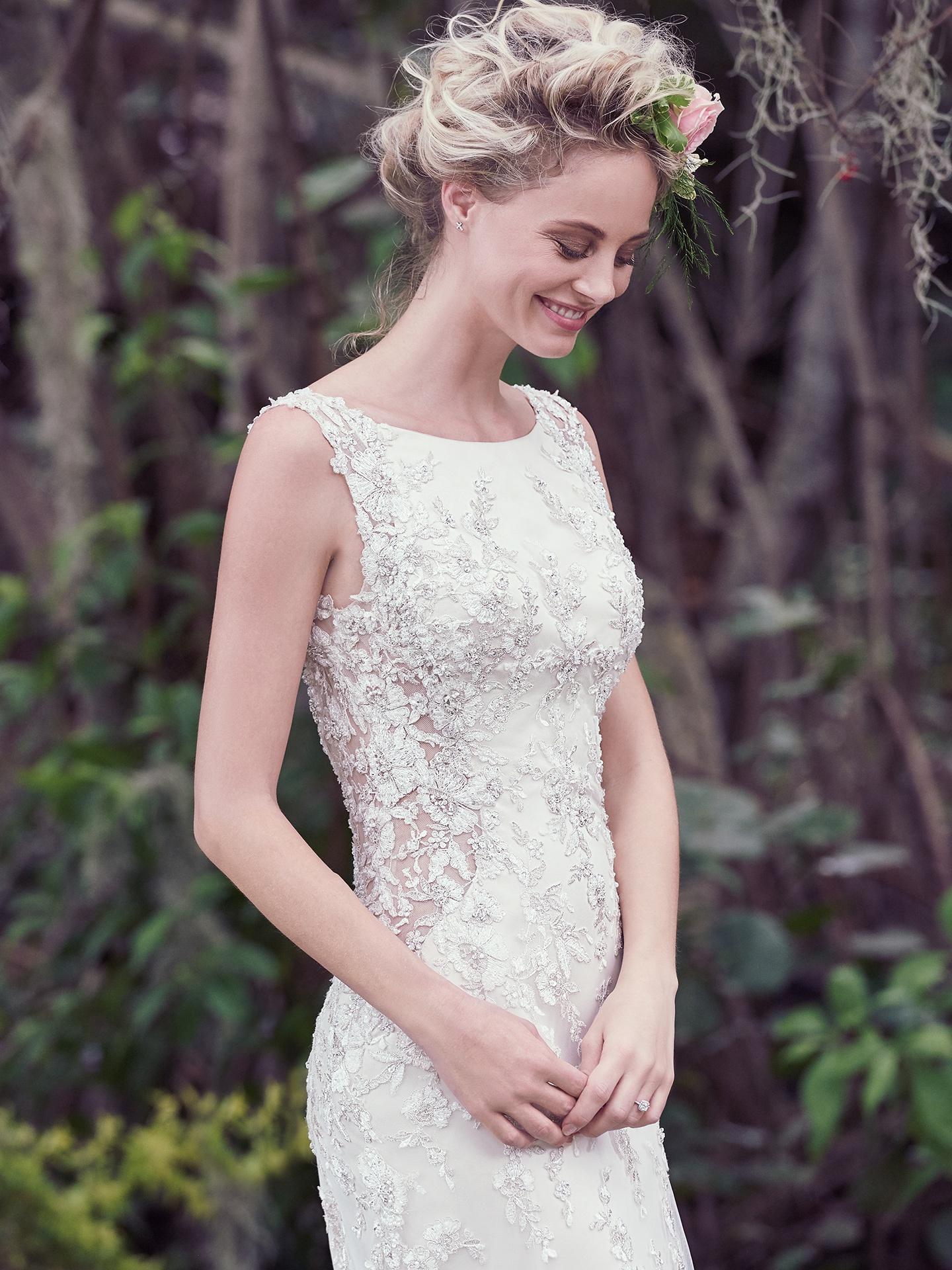 Aspen by Maggie Sottero. Illusion side panels and a keyhole back add a sexy touch to this vintage-inspired wedding dress. This A-Line gown features a bateau neckline and Swarovski crystals atop embellished lace.