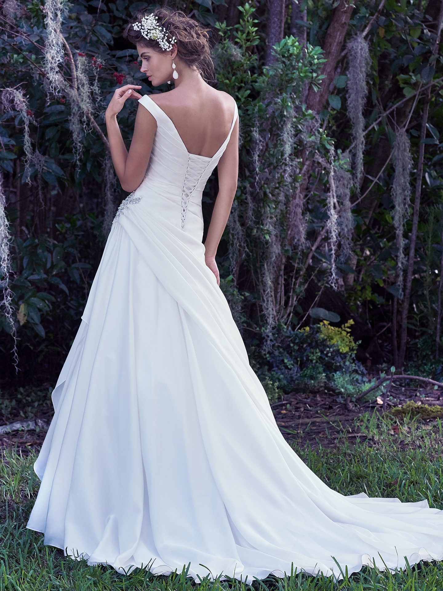Asymmetrical Ruching Adds Movement and Dimension. Wedding Gowns that Look Great in Photos - Harper asymmetrical silk wedding dress with off-the-shoulder sleeves and ruching on the bodice.