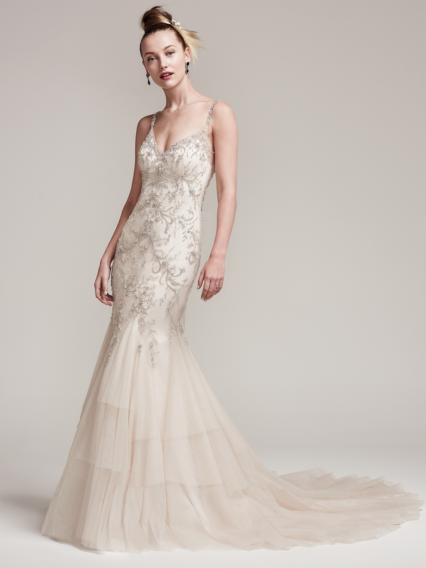 Glittery Mermaid Gown Erin by Sottero and Midgley - Pearls and Swarovski crystals add an extra dose of drama and dimension to this tulle fit and flare wedding dress, complete with bead encrusted spaghetti straps and V-neckline seamlessly flowing into a tiered-godet skirt. Finished with embellished illusion back and crystal buttons over zipper closure.