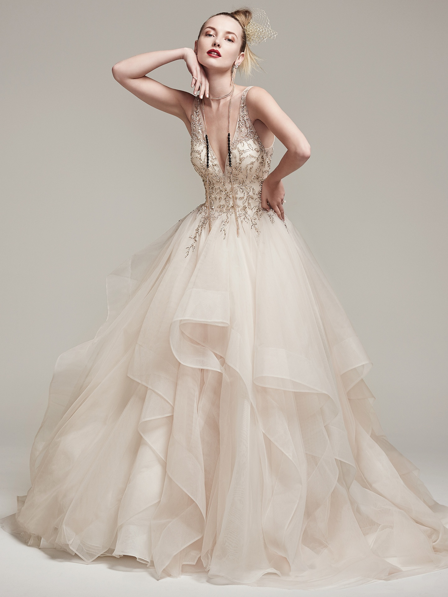 AMÉLIE by Sottero and Midgley. Dione organza creates the dramatic princess wedding gown with horsehair layered ballgown skirt, featuring a breathtaking bodice adorned with Swarovski crystals and pearls, plunging illusion V-neckline and back.