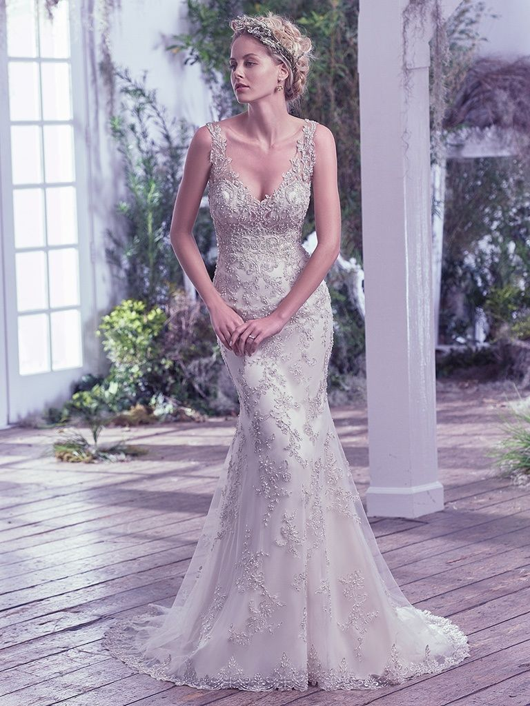 This romantic A-line features a bodice of embellished lace appliqués and an allover lace and tulle skirt - Rylie wedding dress by Rebecca Ingram