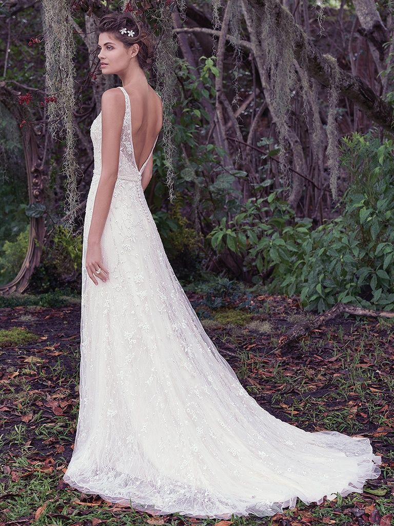 The Ultimate Guide to Wedding Gowns for Curvy Brides from Whitney of CurveGenius - The simple and sleek A-line design of the Jorie wedding dress by Maggie Sottero will hug your curves while giving a little volume in the skirt.
