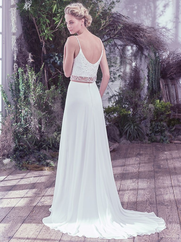Boudoir Photoshoot Inspiration and Boudoir Inspired Wedding Dresses - Gryffin by Maggie Sottero. Effortlessly chic, this Arlo chiffon and tulle two-piece wedding dress, with a Swarovski crystal and tonal bead embellished bodice overlay and sheer midriff, adds an ethereal twist to this classic sheath silhouette. Complete with a soft V-neckline and scoop back. Finished with zipper closure.
