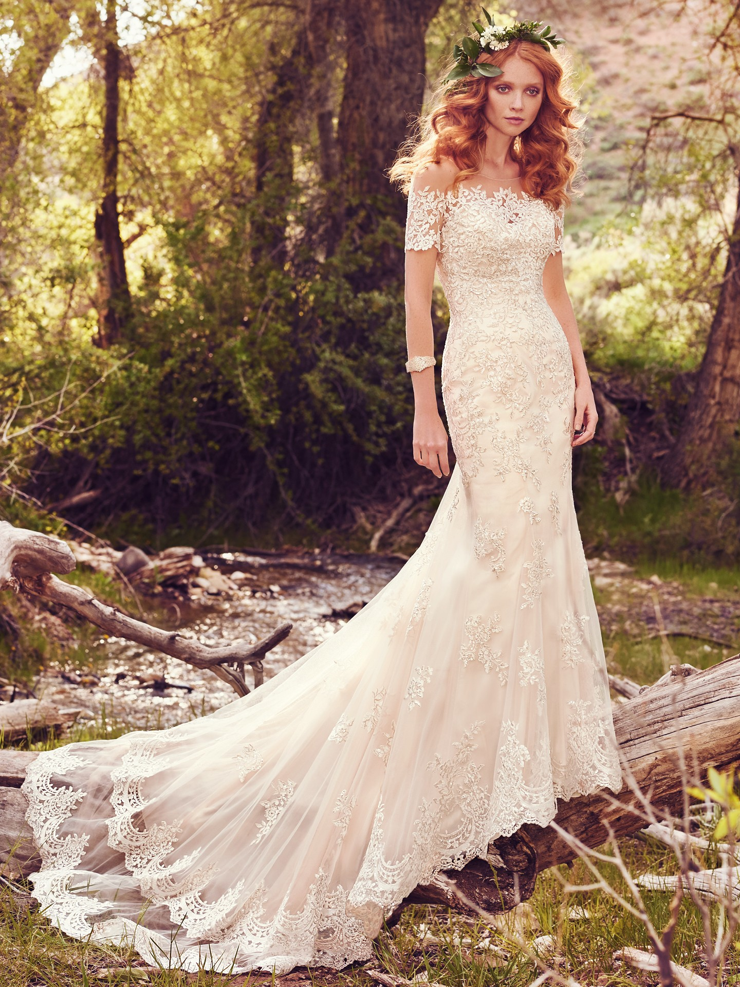 This romantic A-line features a bodice of embellished lace appliqués and an allover lace and tulle skirt - Reynold wedding dress by Rebecca Ingram