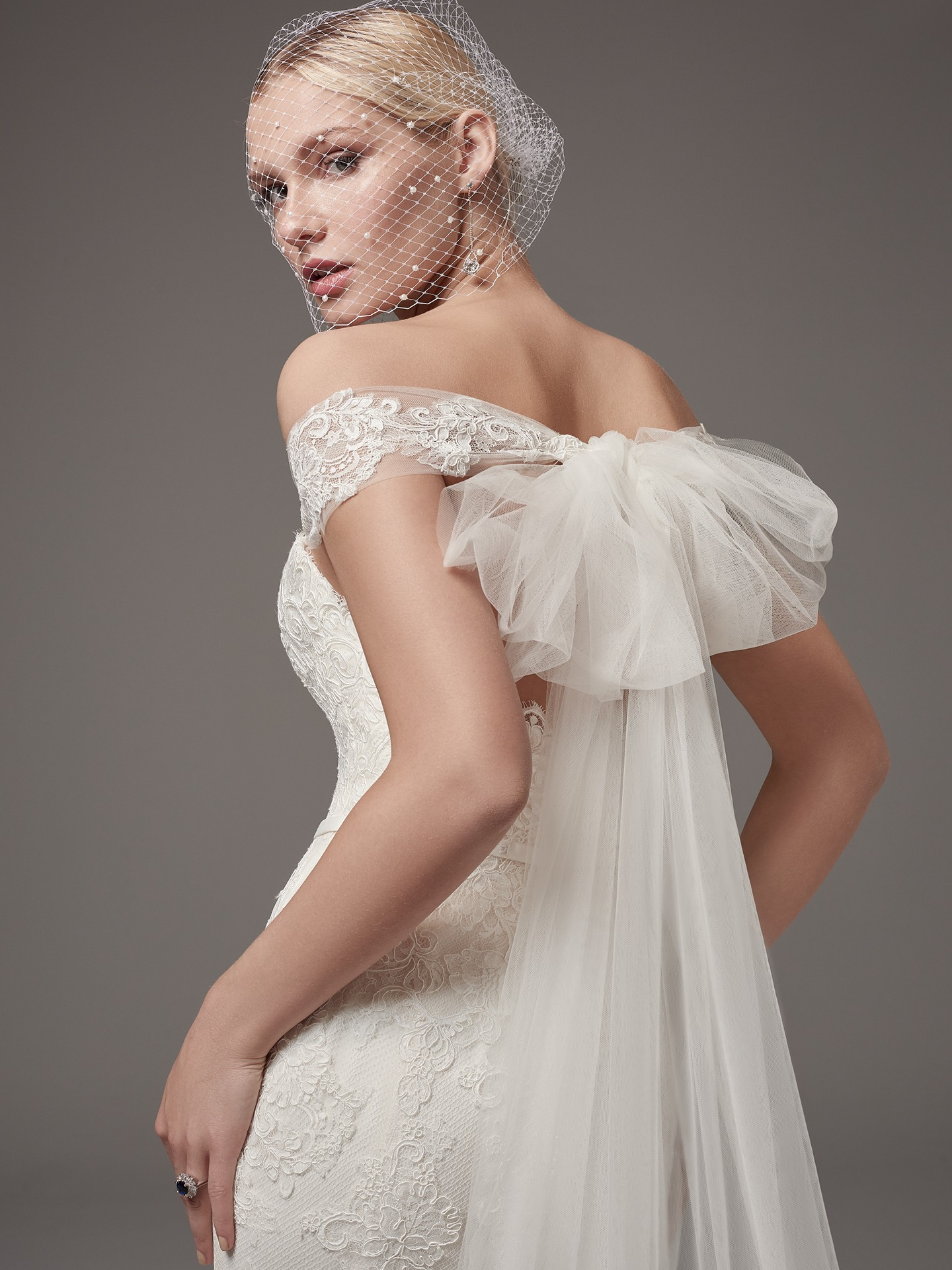 Addison wedding dress by Sottero and Midgley has a statement bow feature on the back, as well as a delicate belt with a bow. - The Latest Wedding Dress Trends for Engagement Season 2018