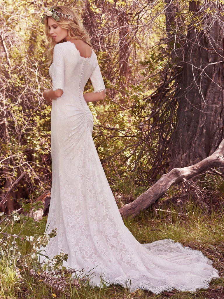 The Ultimate Guide to Wedding Gowns for Curvy Brides from Whitney of CurveGenius - Try the McKenzie Marie modest wedding dress by Maggie Sottero for full coverage.