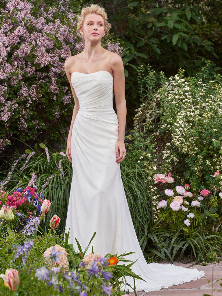 Find the perfect gown for your wedding dress budget with Maggie Sottero's guide. Linda wedding dress by Rebecca Ingram.