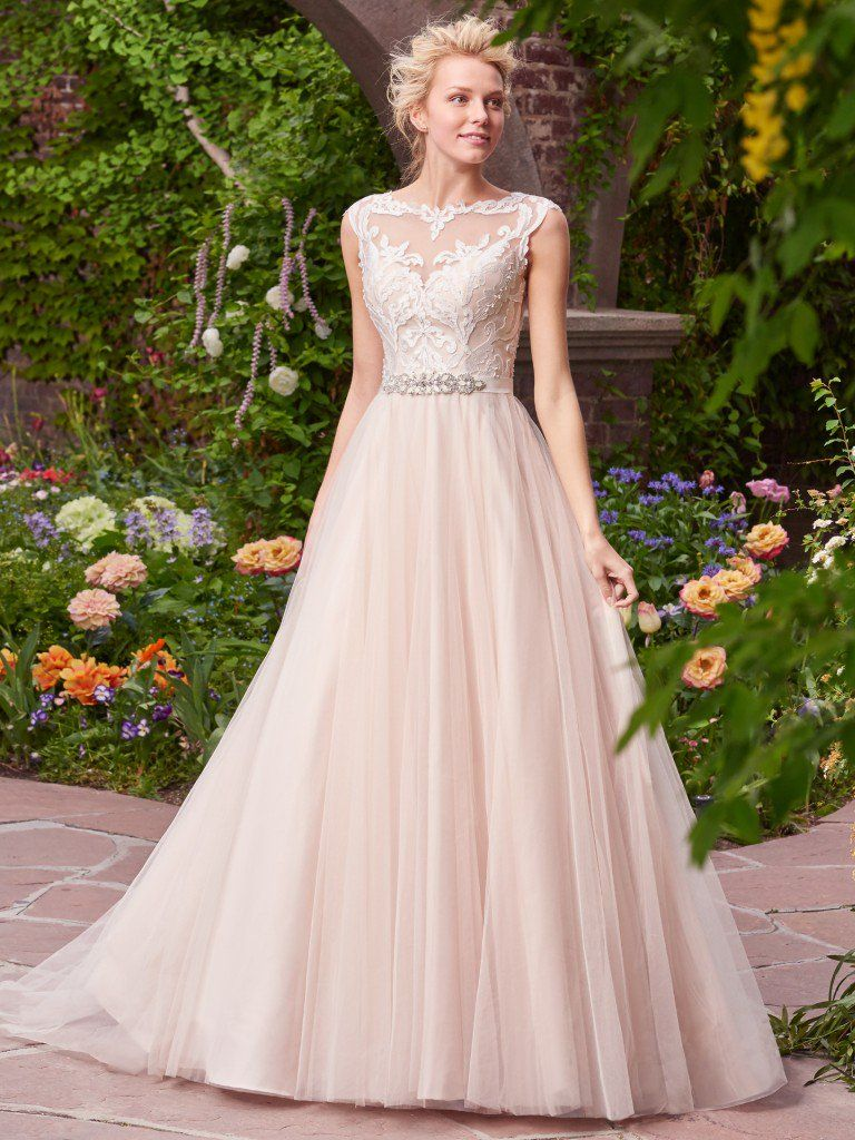 Find the perfect gown for your wedding dress budget with Maggie Sottero's guide. Carrie wedding dress by Rebecca Ingram.
