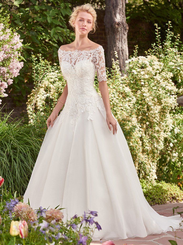 Beautiful ballgowns: Darlene by Rebecca Ingram. This classic tulle over Chic organza ballgown features a sweetheart neckline and a lovely lace bodice. Finished with corset closure, or covered buttons over zipper and inner elastic closure. Off-the-shoulder lace jacket with elbow-length sleeves sold separately.