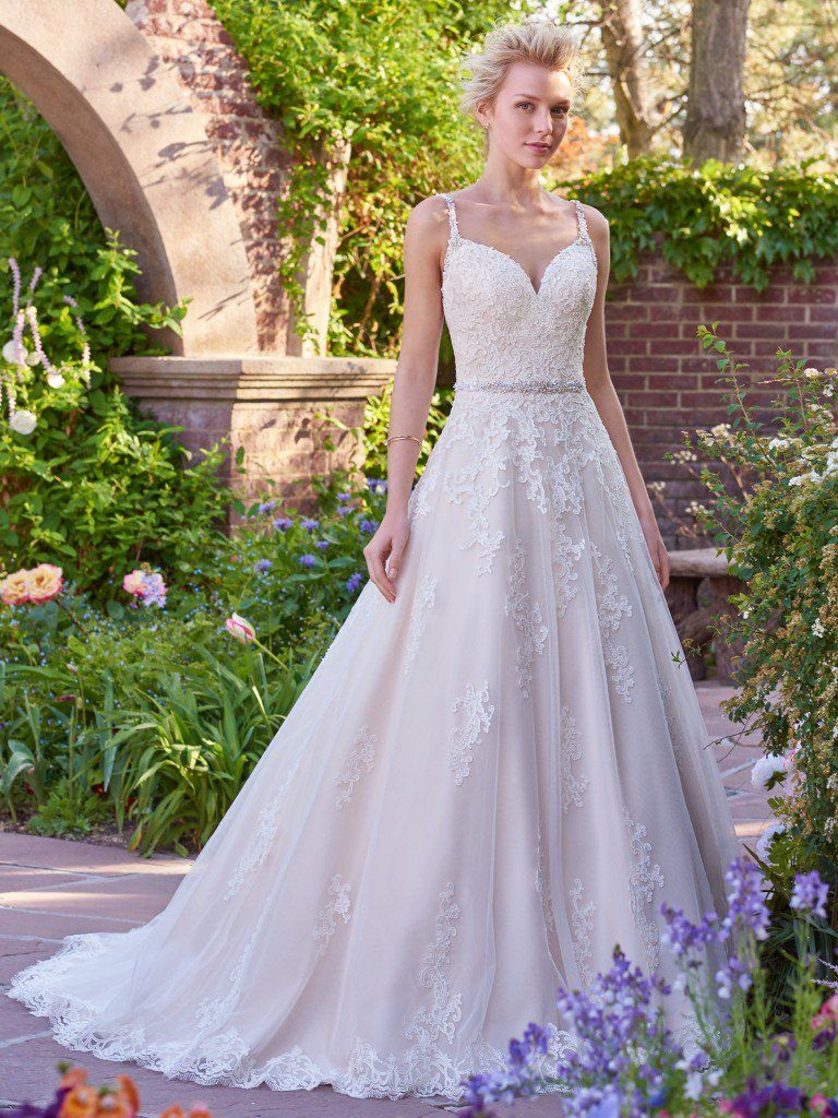 Beautiful ballgowns: Allison by Rebecca Ingram. This gorgeous ballgown features a layer of lace appliqués over tulle. A V-neckline and open back with lace illusion trim add hints of alluring romance. Accented with Swarovski crystal belt and embellished straps. Finished with covered buttons and zipper closure.