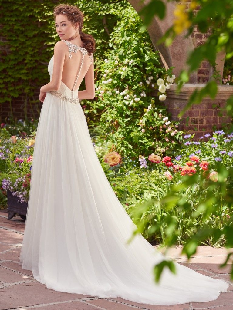Best Accessories for Your Boho Wedding Dress - Shelley boho wedding dress by Rebecca Ingram paired with a a subtle fringed white jacket from Anthropologie
