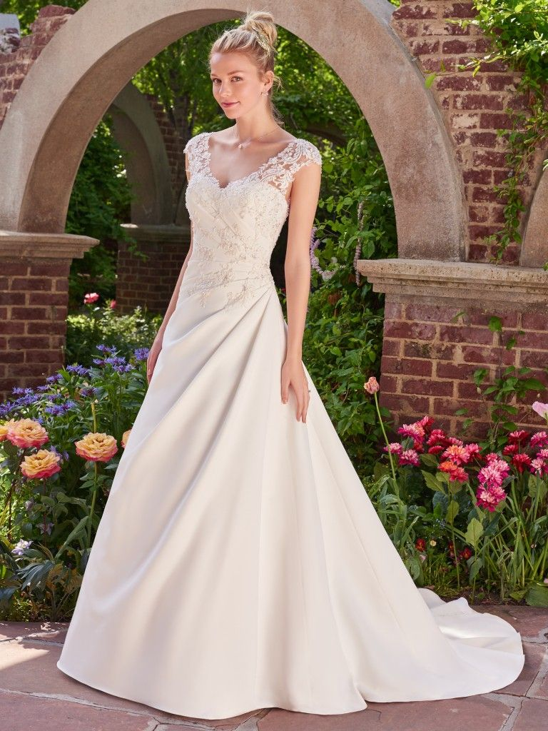 Famous Weddings Throughout History - For a formal and romantic wedding day look, try our silk Sigrid wedding dress from Rebecca Ingram