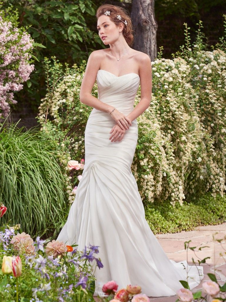 Find the perfect gown for your wedding dress budget with Maggie Sottero's guide. Persephone wedding dress by Rebecca Ingram.