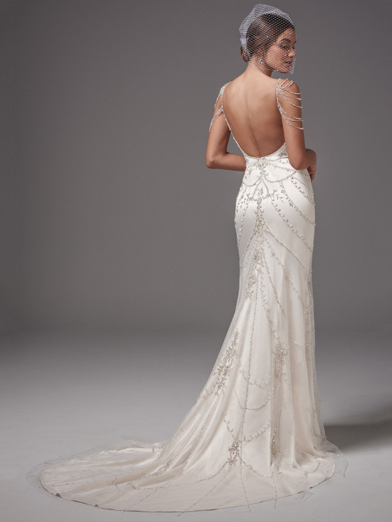 The Best Slip Dresses for the Chic and Relaxed Bride. This vintage-inspired Ava satin wedding dress features ribbons of pearl and Swarovski crystal embellishments, accented with beaded straps and shoulder treatment. Sheath silhouette, scoop neck, and open back evoke sexy sophistication. Finished with zipper closure. Dominique by Sottero and Midgley
