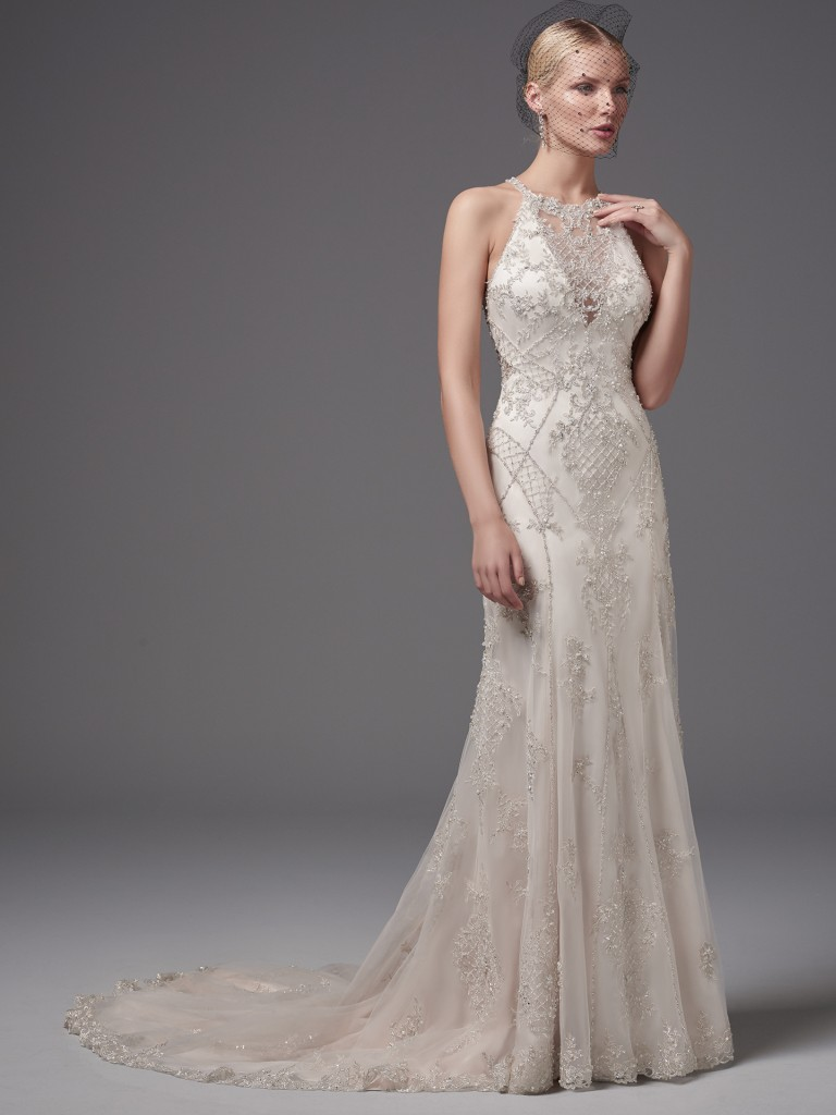 Shimmering beaded lace appliqués and crosshatching add luster and dimension to this glamorous sheath, highlighting the waistline, illusion halter over V-neck, and illusion open back. Felicia by Sottero and Midgley