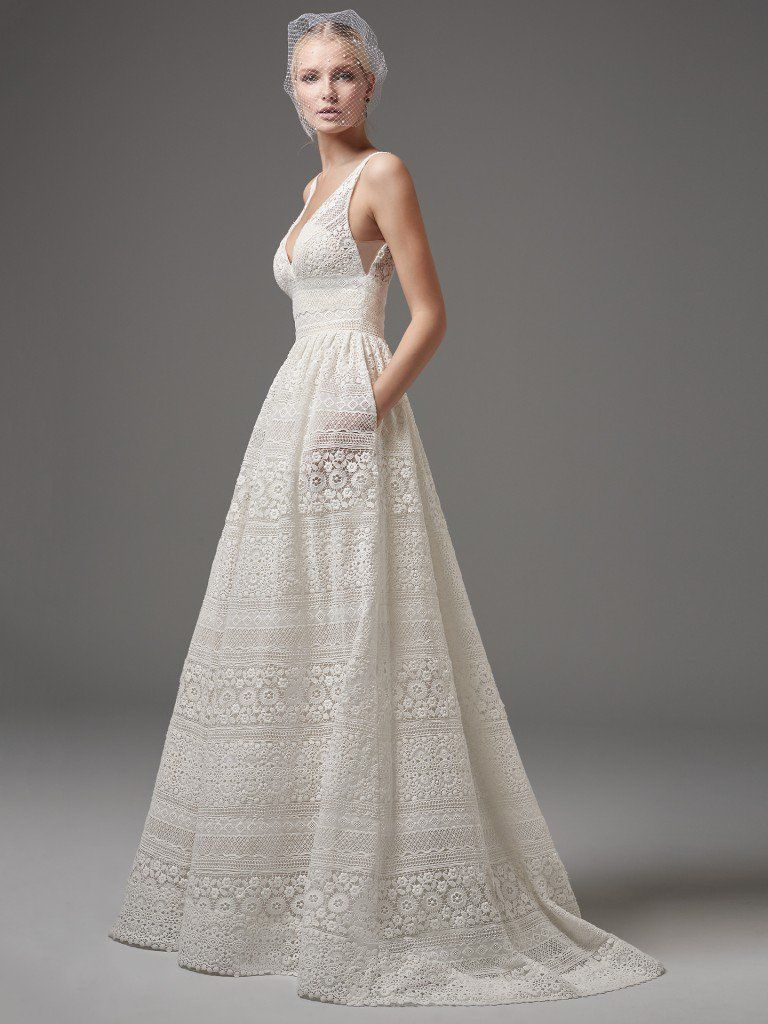 Evan by Sottero and Midgley is the sultry, not too sweet, lace wedding dress destined for your rustic-yet-elegant soiree. Featuring geometric motifs and a deep V-neck and square back, this A-line gets an A+ in polish and charisma. Detachable tulle overskirt (sold separately) adds dimension to this look, and you just can't say no to those hidden pockets…