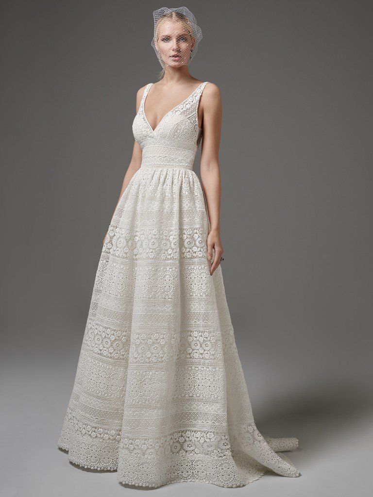 Famous Weddings Throughout History - For a low-key wedding day look, try the Evan wedding dress by Sottero and Midgley