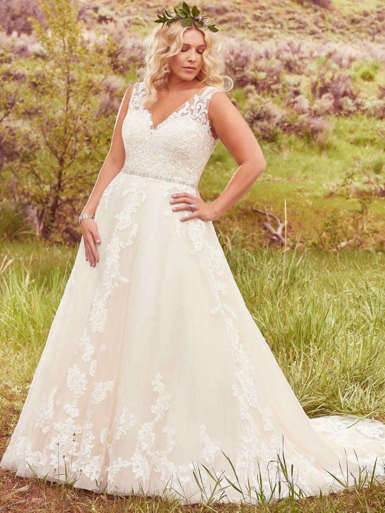 Beautiful ballgowns: Sybil by Maggie Sottero. This exquisite ball gown wedding dress is complete with floral lace appliques drifting down a tulle skirt, an elegant illusion V-neckline, and a glittering Swarovski crystal belt. Finished with plunging V-back and crystal buttons over zipper closure.