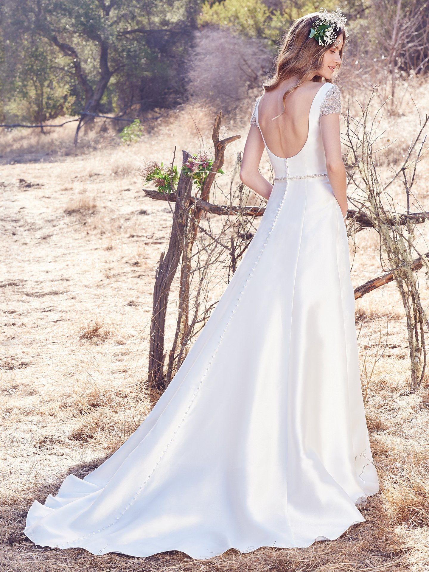 Beaded cap-sleeves and dazzling beaded belt with Swarovski crystals add opulence to this simple yet elegant Yaron Mikado A-line wedding dress, featuring a bateau neckline and scoop back. Wedding Dresses With Beaded Cap Sleeves