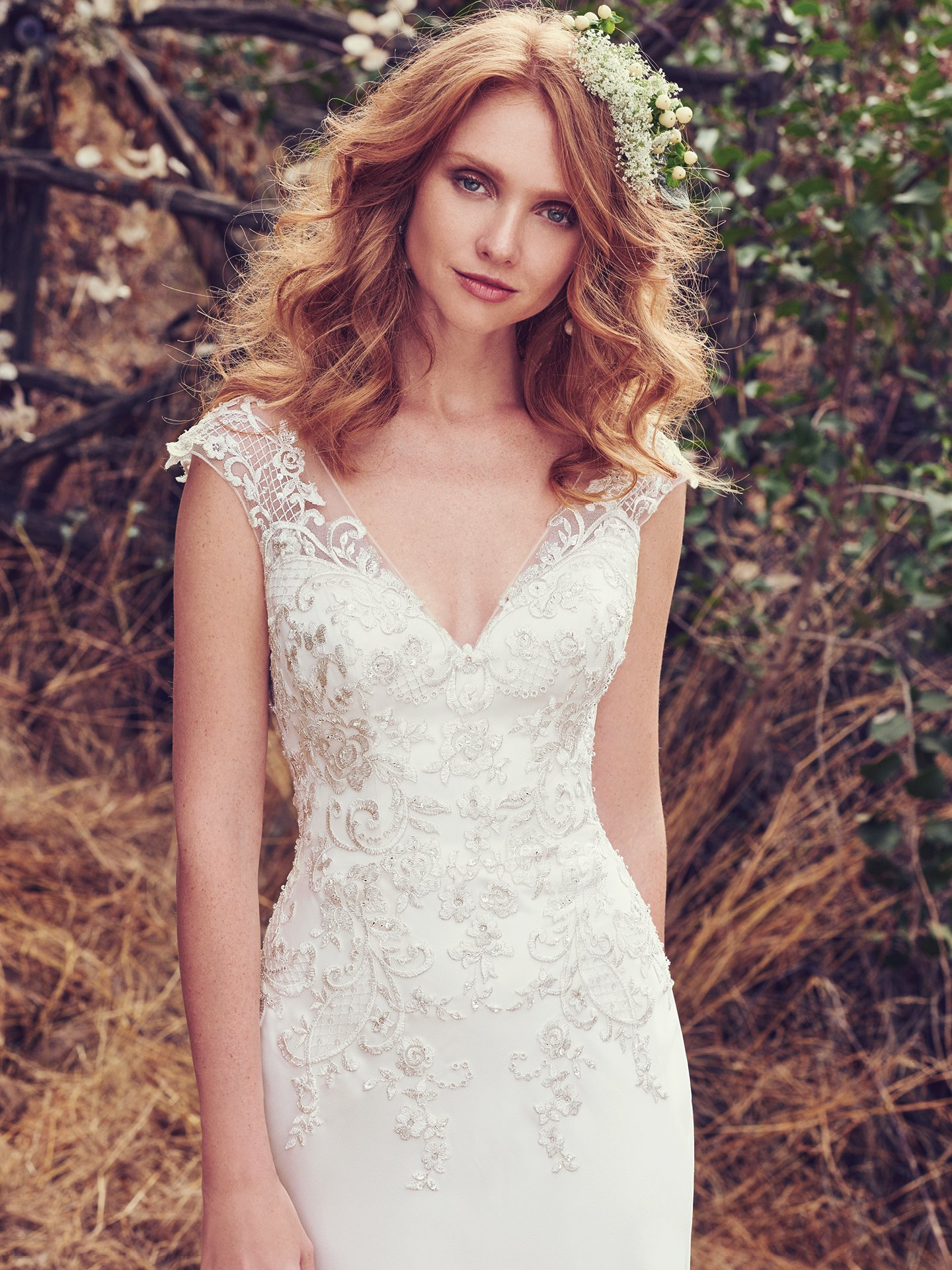 Slip Style Wedding Dresses Chic and Relaxed Brides. Estelle by Maggie Sottero. This romantic Orlando Satin sheath features lace appliqués accented in beads and Swarovski crystals along the bodice, illusion V over sweetheart neckline, cap-sleeves, and open V-back. A cutout train comprised of illusion lace appliqués completes the unique glamour of this wedding dress. Finished with zipper closure.