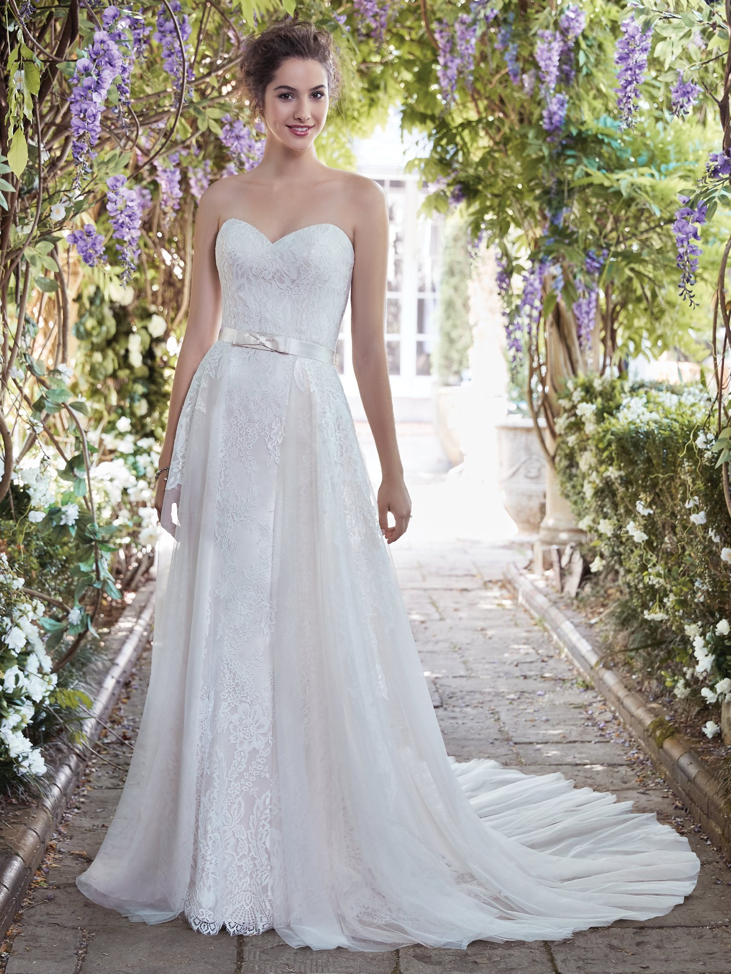 Octavia wedding dress with cute tulle overskirt and silk bow. - The Latest Wedding Dress Trends for Engagement Season 2018