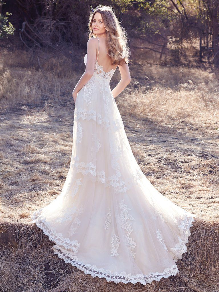 Best Accessories for Your Boho Wedding Dress - Emily boho wedding dress by Maggie Sottero paired with a Macrame fringe purse