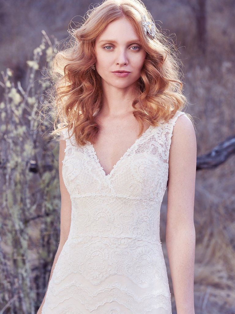 Best Accessories for Your Boho Wedding Dress - Boho wedding dress Brynn by Maggie Sottero paired with a beautiful boho flower crown