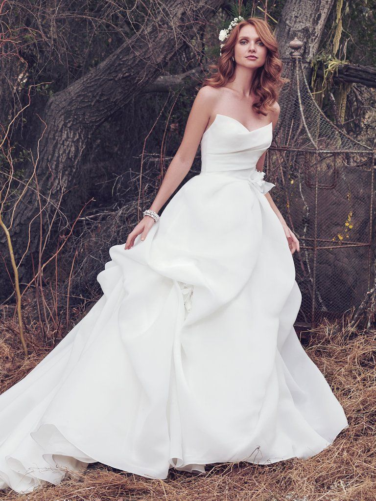 A super modern silhouette in a premium fabrication is a homerun for photos. Wedding Gowns that Look Great in Photos - Meredith wedding dress by Maggie Sottero