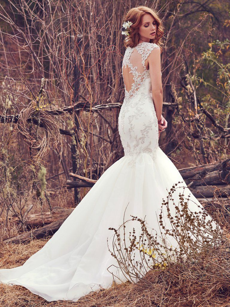 The Ultimate Guide to Wedding Gowns for Curvy Brides from Whitney of CurveGenius - The Payson wedding dress by Maggie Sottero has a close-fitting bodice and charming back design.