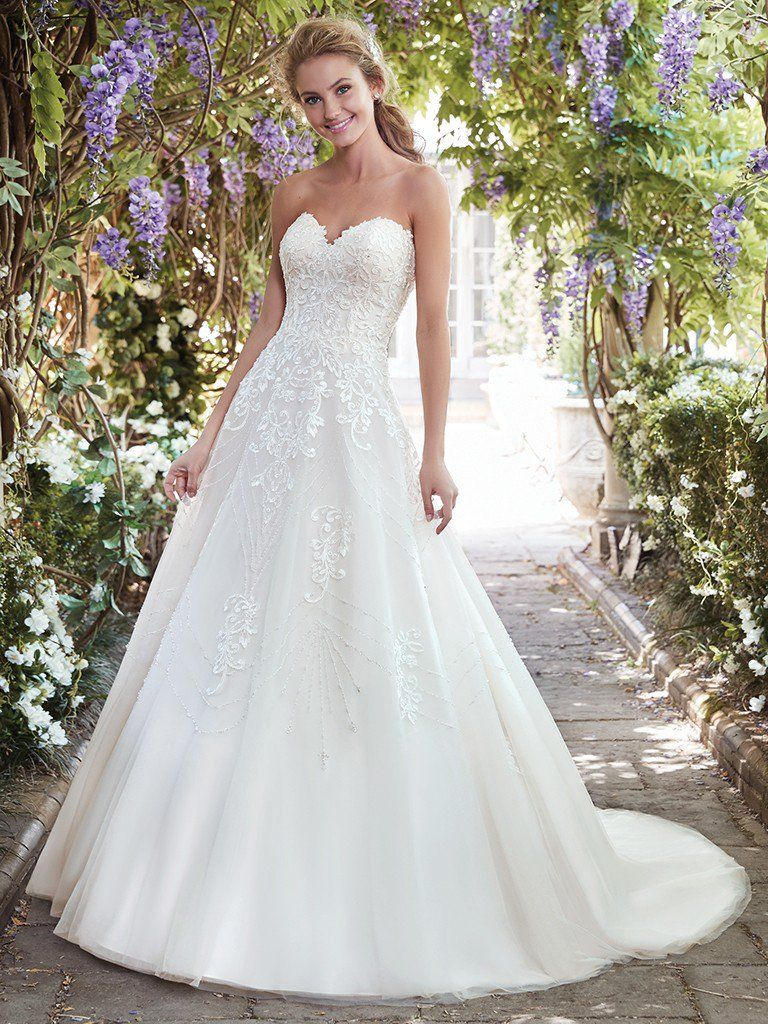 Find the perfect gown for your wedding dress budget with Maggie Sottero's guide. Edith wedding dress by Rebecca Ingram.