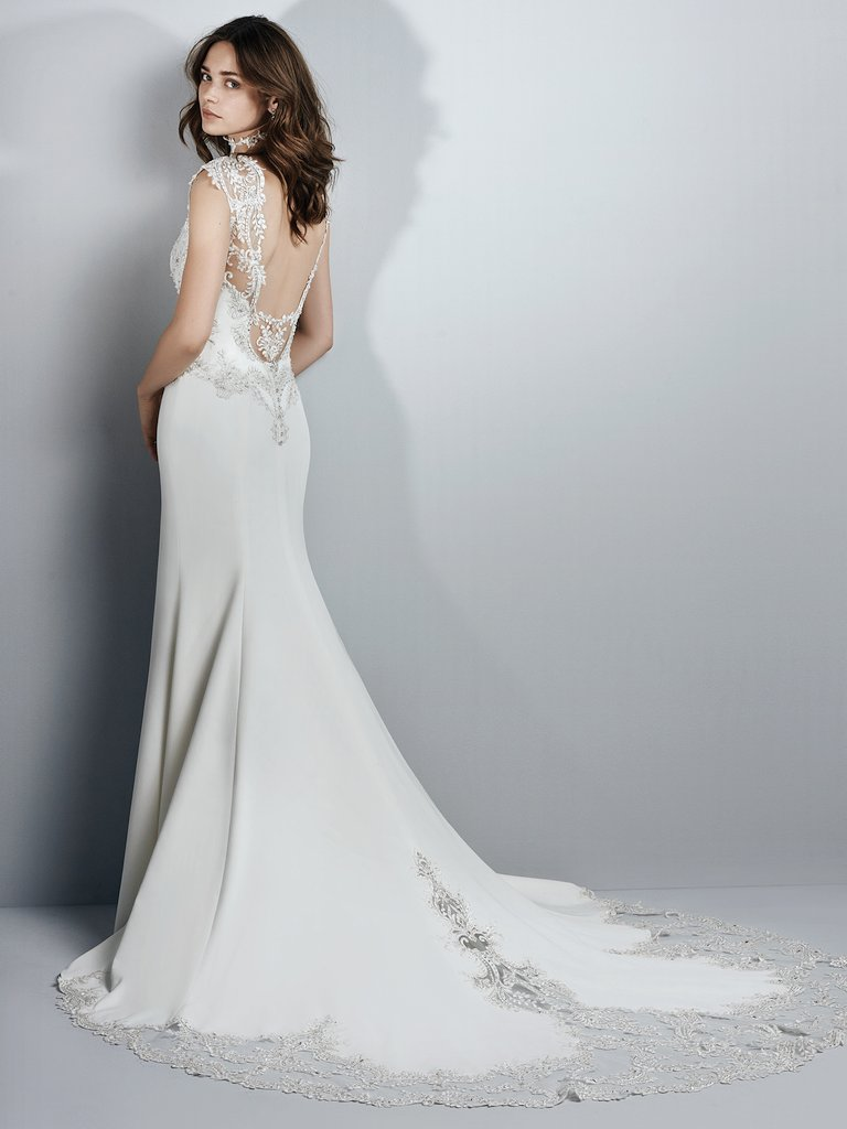 The Best Slip Dresses for the Chic and Relaxed Bride. Beaded lace appliqués accent the bodice, illusion sweetheart neckline, illusion cap-sleeves, and illusion scoop back in this Aldora Crepe wedding dress. A gorgeous illusion cutout train accented in beaded lace appliqués completes the alluring romance of this sheath. Finished with crystal buttons over zipper closure. Kai by Sottero and Midgley