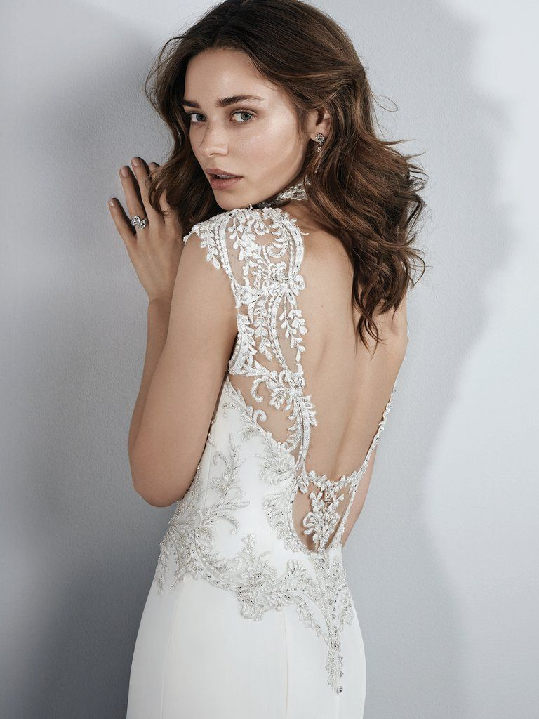 Boudoir Photoshoot Inspiration and Boudoir Inspired Wedding Dresses - Kai by Sottero and Midgley. Beaded lace appliqués accent the bodice, illusion sweetheart neckline, illusion cap-sleeves, and illusion scoop back in this Aldora Crepe wedding dress. A gorgeous illusion cutout train accented in beaded lace appliqués completes the alluring romance of this sheath. Finished with crystal buttons over zipper closure.