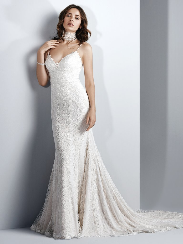 The Best Slip Dresses for the Chic and Relaxed Bride. This boho wedding dress features unique textured lace over a layer of Inessa Jersey in a sheath silhouette. Spaghetti straps complete the sweetheart neckline and illusion scoop back accented in lace appliqués. Finished with crystal buttons over zipper closure. Narissa by Sottero and Midgley