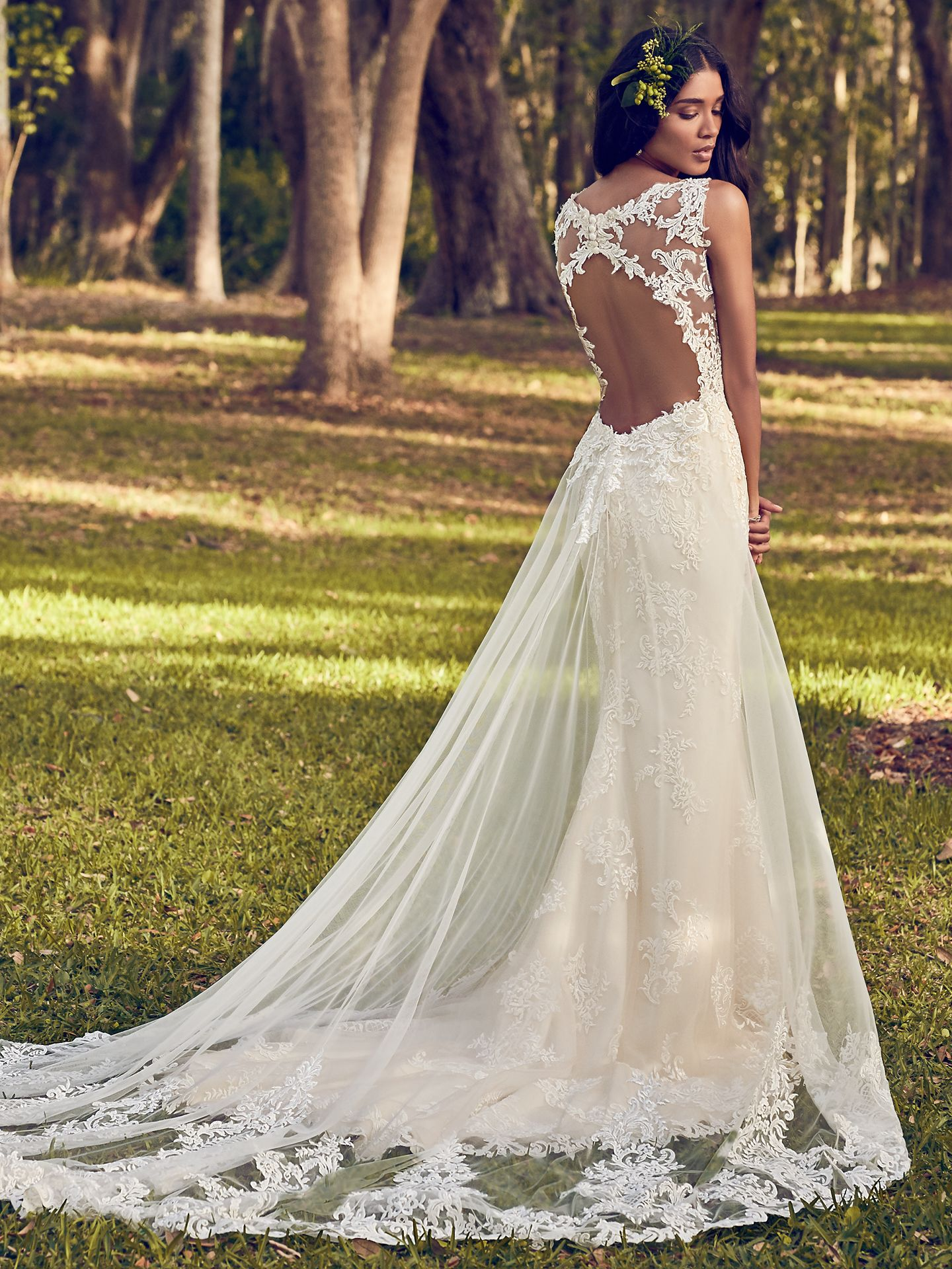 Beaded lace motifs dance over tulle in this sheath wedding dress, accenting the illusion plunging V-neckline, illusion straps, and illusion back with keyhole. Finished with covered buttons over zipper closure. Detachable tulle train accented in lace motifs sold separately. - The Latest Wedding Dress Trends for Engagement Season 2018