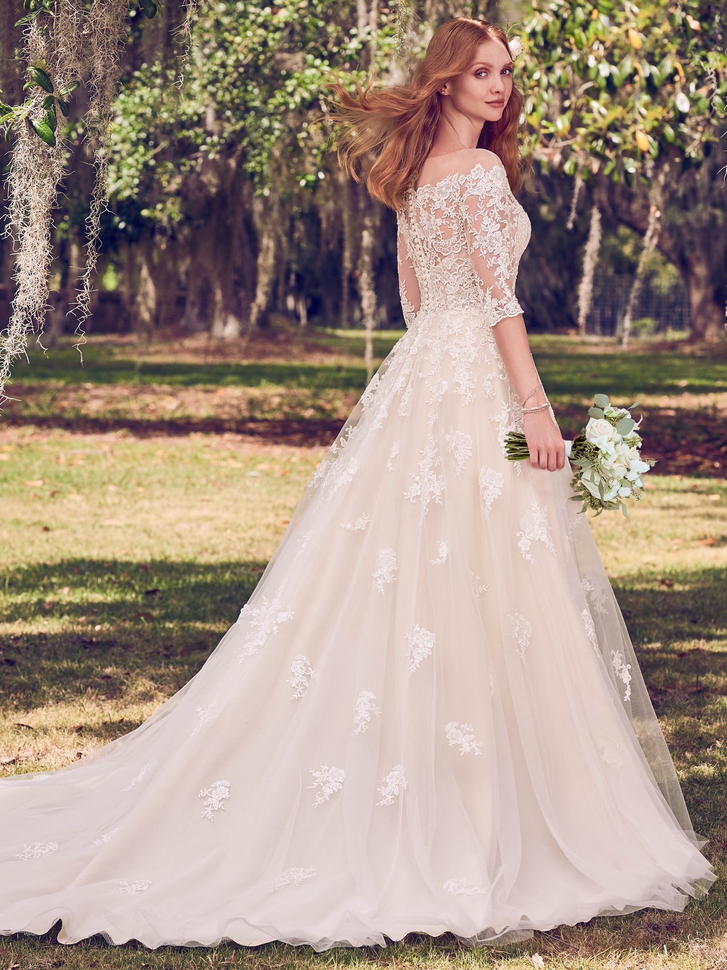 Scalloped illusion off the shoulder neckline on subtly sexy wedding dress Bree by Maggie Sottero