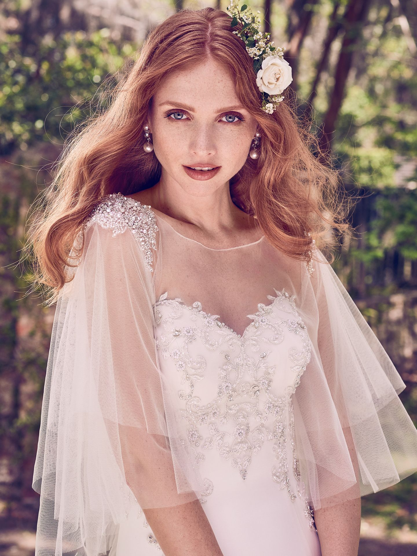 Quintyn features a vintage-inspired capelet - a little vintage, a little fairytale, a lot of eye-catching. - The Latest Wedding Dress Trends for Engagement Season 2018