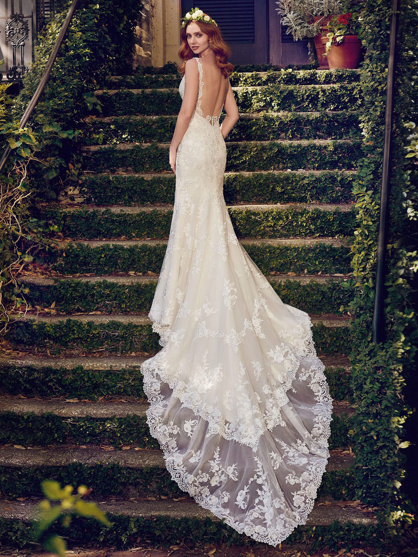 Zamara wedding dress features shimmering lace motifs adorn this tulle sheath wedding dress, completing the illusion double-train, illusion open back, V-neck, and illusion straps. - The Latest Wedding Dress Trends for Engagement Season 2018