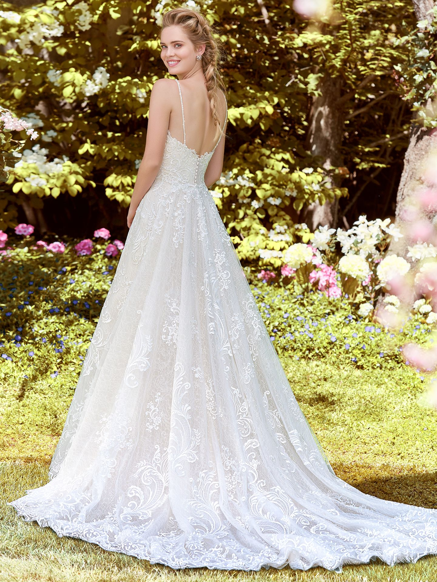 Swirls of romantic lace motifs dance over textured tulle in this fit-and-flare gown, complete with sweetheart neckline and beaded spaghetti straps. Finished with covered buttons over zipper closure. Detachable textured tulle train accented in sequins and lace sold separately. - The Latest Wedding Dress Trends for Engagement Season 2018