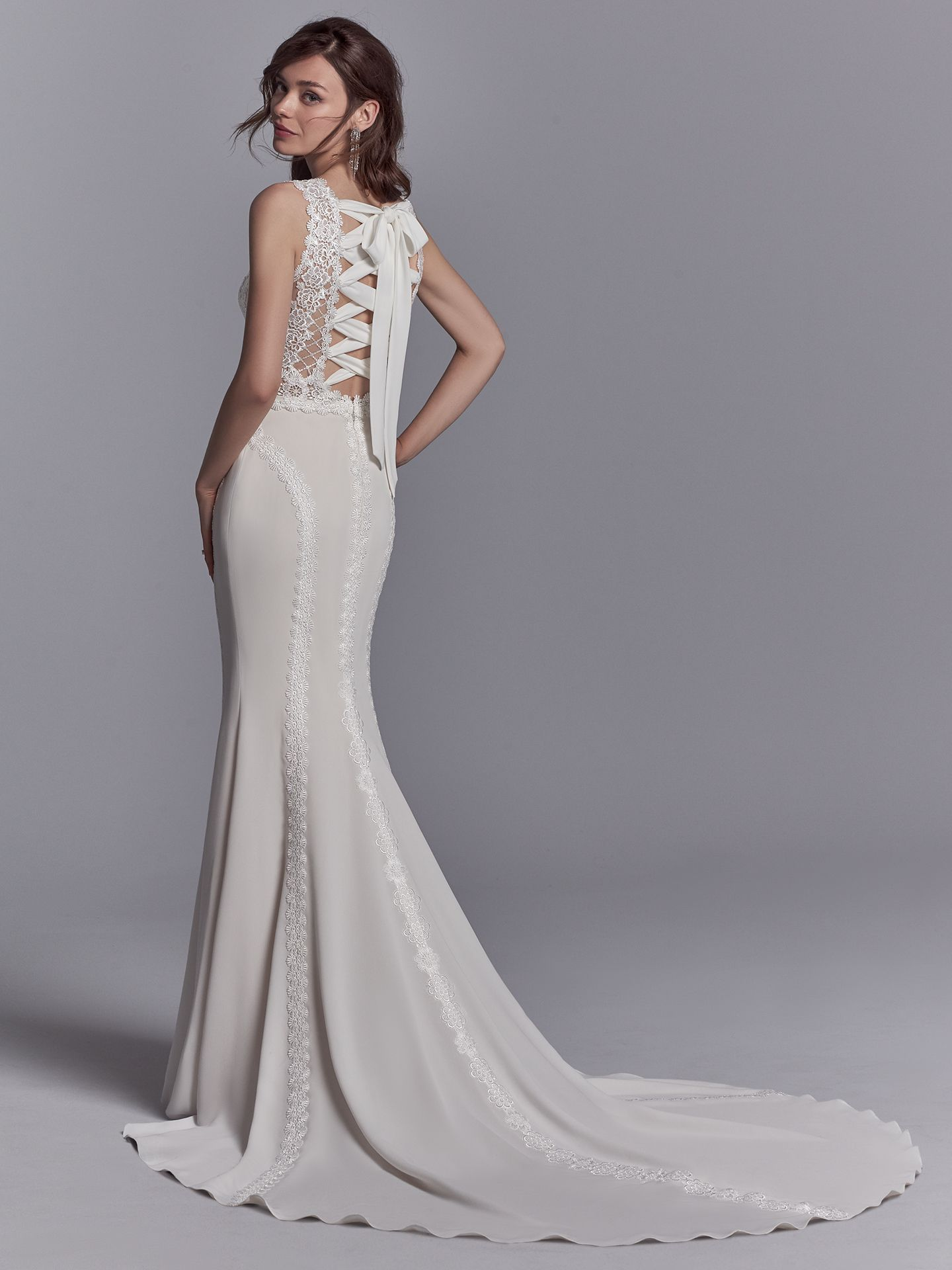 The Barrington wedding dress features an inverted lace-up corset detail topped with a bow. - The Latest Wedding Dress Trends for Engagement Season 2018