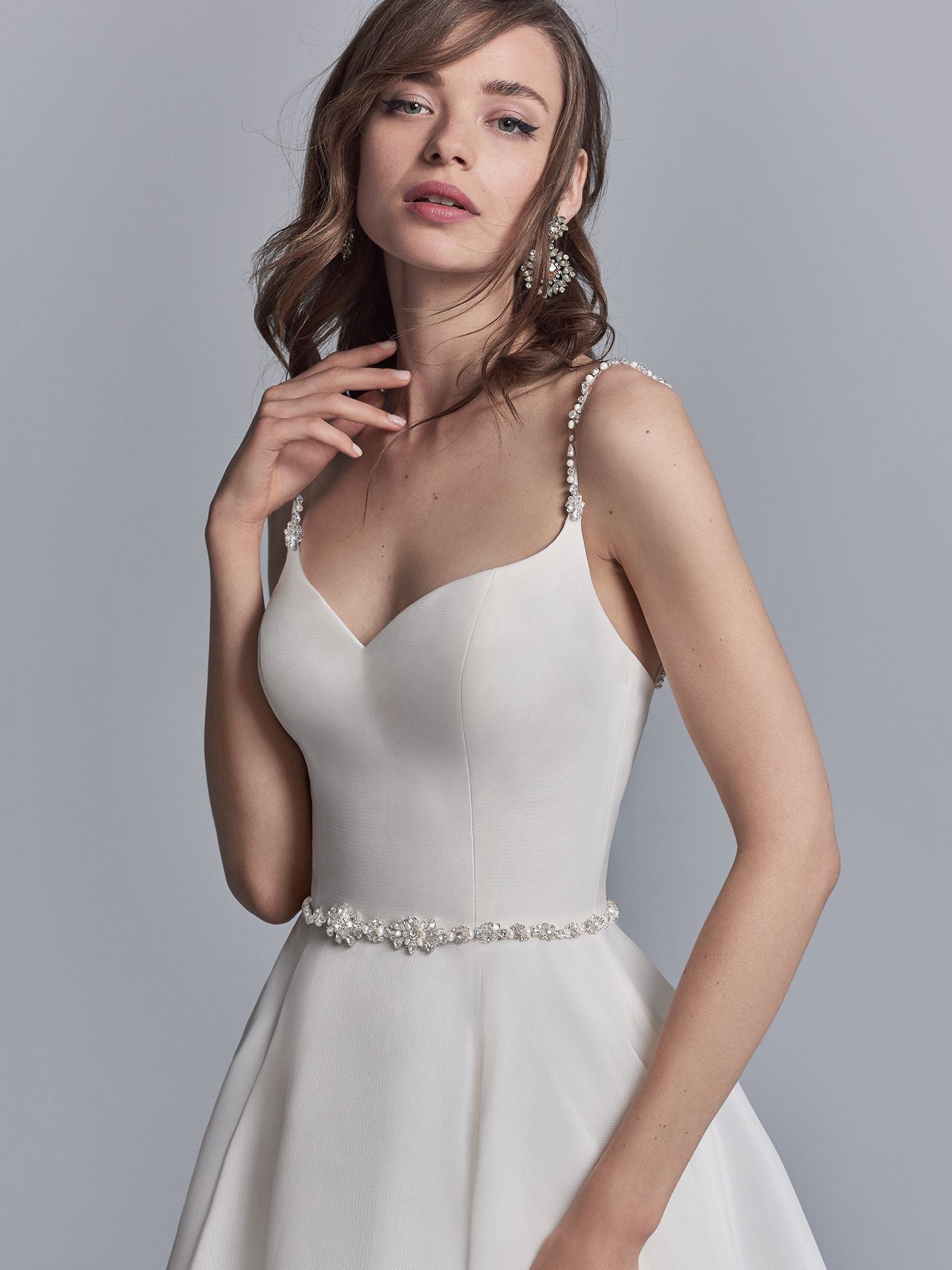 Comprised of Shavon Organza, this classic wedding dress features delicate beaded spaghetti straps and a beaded belt, both accented in Swarovski crystals. A sweetheart neckline completes this chic A-line gown. - The Latest Wedding Dress Trends for Engagement Season 2018