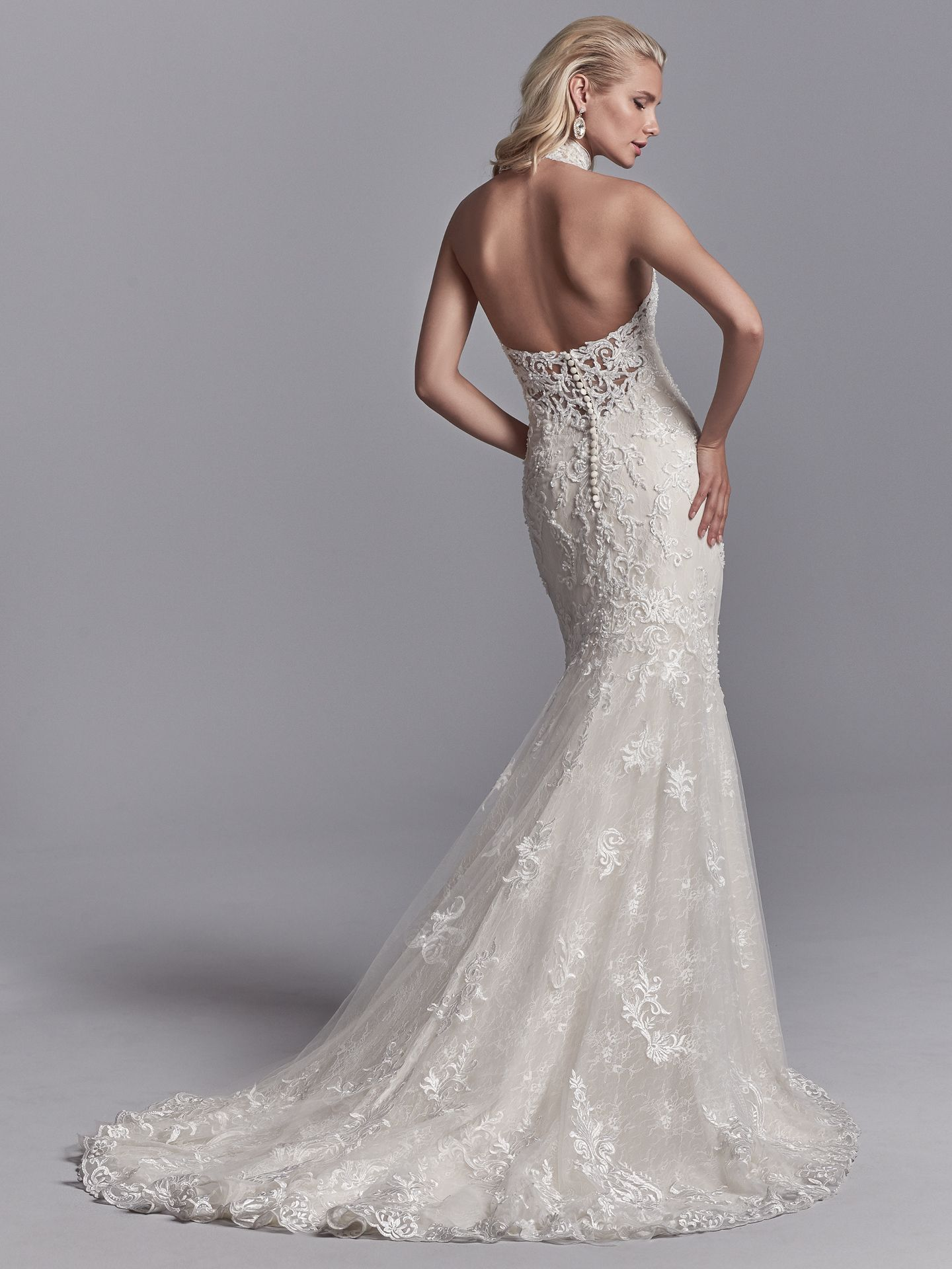 Nerida by Sottero and Midgley. Embroidered lace motifs and beading cascade over textured tulle in this fit-and-flare wedding dress, trimming the illusion halter over sweetheart neckline and illusion scoop back. These 10 Romantic Gowns are Maggie Sottero's Top-Pinned of 2017!