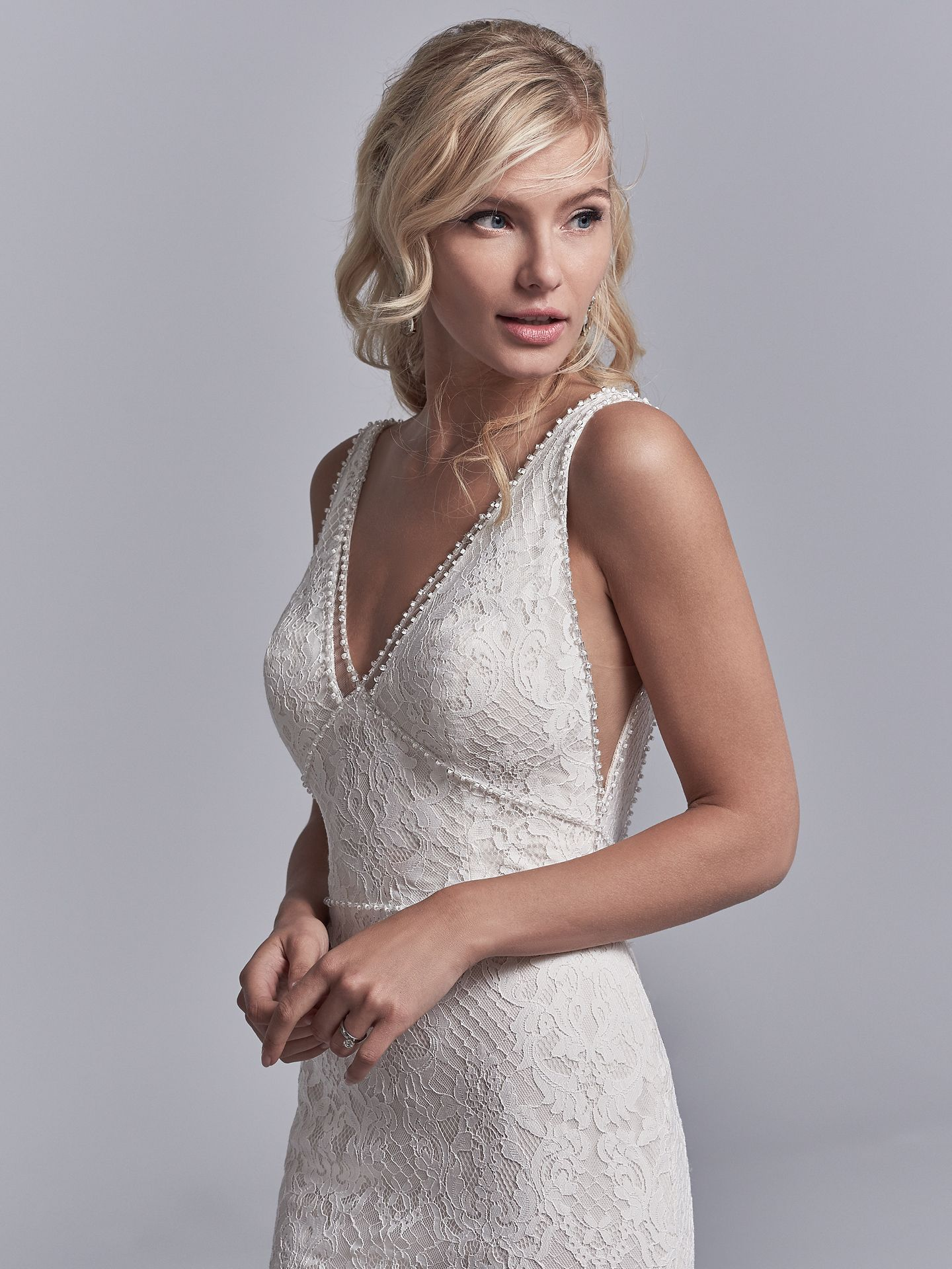 Regan wedding dress features allover lace motifs cascade over crosshatched tulle in this fit-and-flare wedding dress.  - The Latest Wedding Dress Trends for Engagement Season 2018