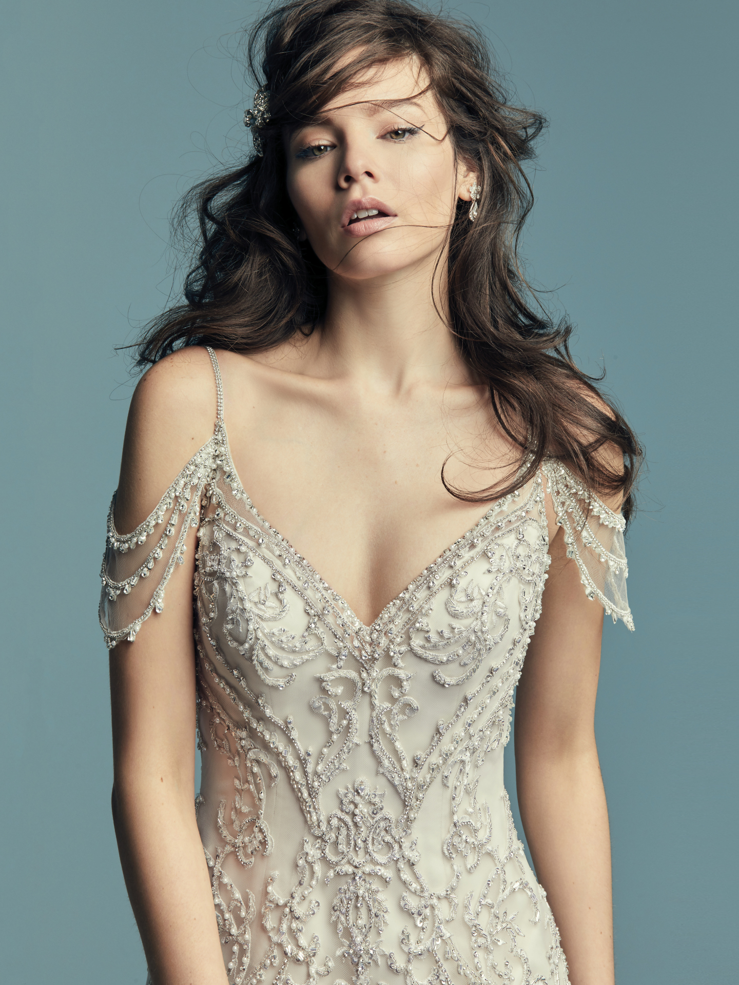 Cold shoulder beaded sleeves for a unique shoulder treatement. Fabulous Wedding Dresses With a Variety of Beaded Sleeves