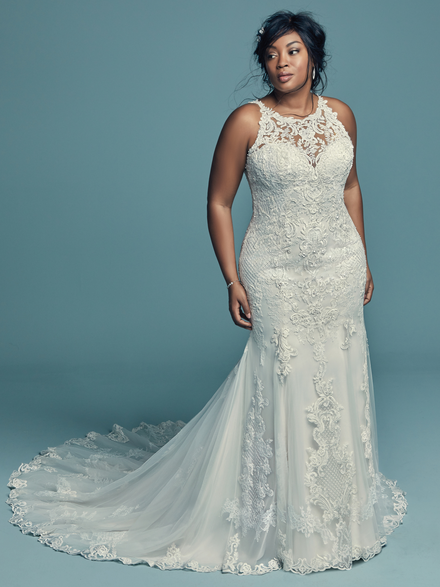 a plus size wedding dress by Maggie Sotero