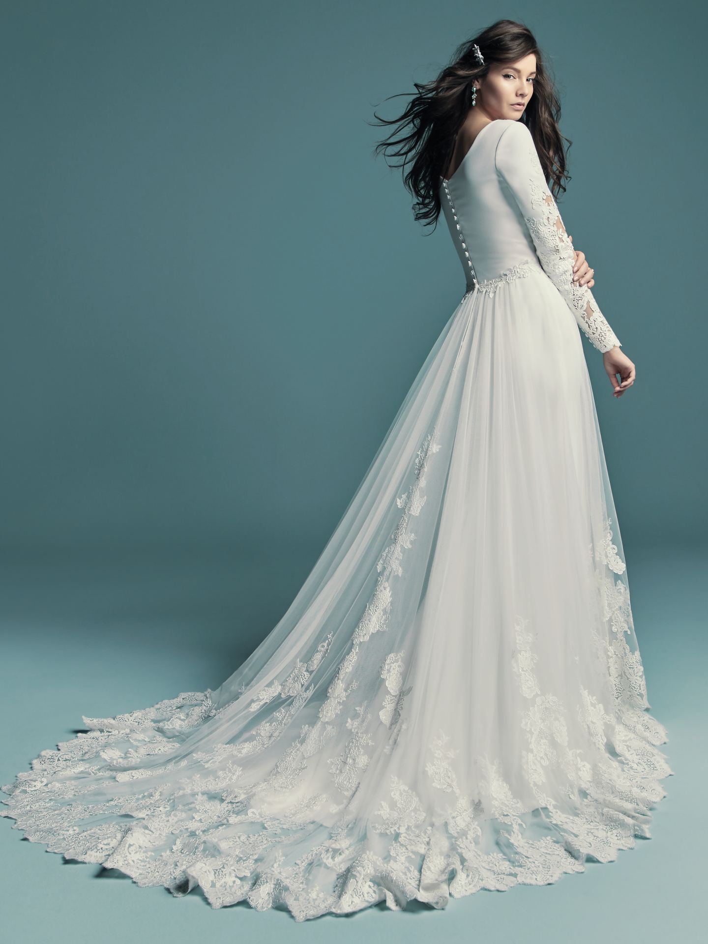 The Ultimate Guide to Wedding Gowns for Curvy Brides from Whitney of CurveGenius - Try the Olyssia wedding dress by Maggie Sottero for full coverage and overskirt option