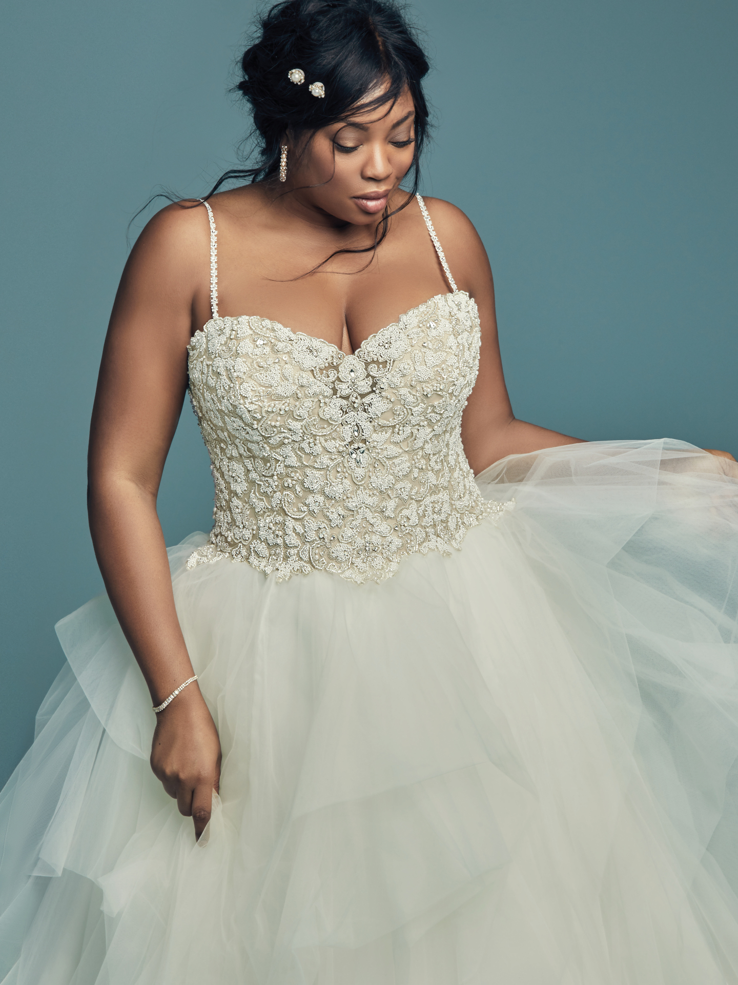 The Ultimate Guide to Wedding Gowns for Curvy Brides from Whitney of CurveGenius - Try the Shauna lynette wedding dress by Maggie Sottero and feel confident as you dance the night away